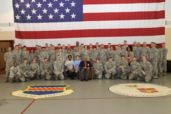 Former U.S. Army Air Corps Cpl Robert Holts, the sole surviving original Tuskegee Airman from Nebraska, poses with students of the James M. McCoy Airman Leadership School here Nov. 25.  Also in attendance were some members of the Alfonza W. Davis Chapter of Tuskegee Airmen, who came together with the ALS to honor Holts on his 92nd birthday. (U.S. Air Force photo by Jeff Gates)