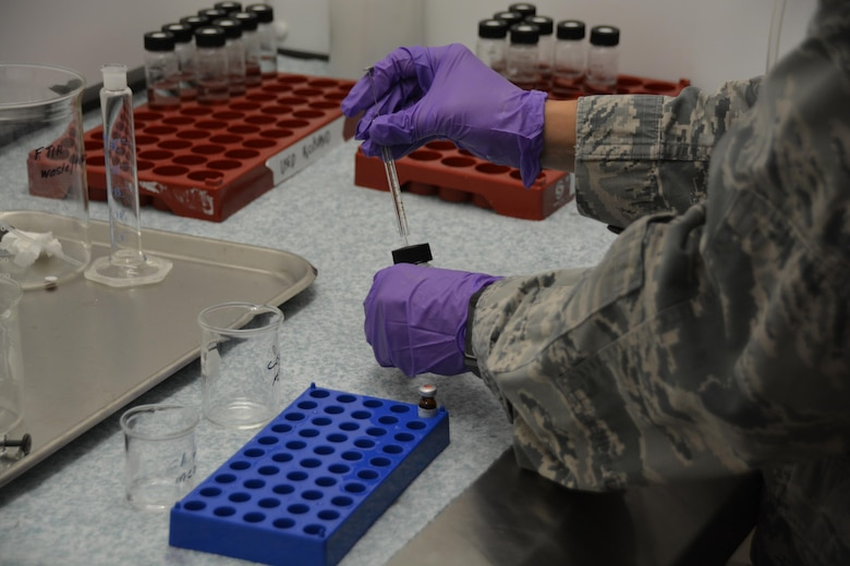 A bioenvironmental engineering Airman analyzes a sample as part of the Individual Proficiency Analytical Testing program. I-PAT is part of the 711th Human Performance Wing's United States Air Force School of Aerospace Medicine and tests the proficiency and preparedness of more than 1,400 BE Airmen worldwide to detect, respond to and effectively perform mission-critical health risk assessments on analytes of question in an occupational or unknown environment. (U.S. Air Force photo/Kim Bowden)