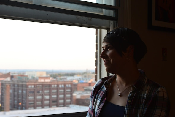 Staff Sgt. Ashleigh Buch, an instructor with the 338th Combat Training Squadron at Offutt Air Force Base, Neb., looks out over the city of Omaha from her apartment Oct. 20, 2016. Buch is the first openly serving transgender Airman to be recommended for a return to flying duties. (U.S. Air Force photo/Senior Airman Rachel Hammes)