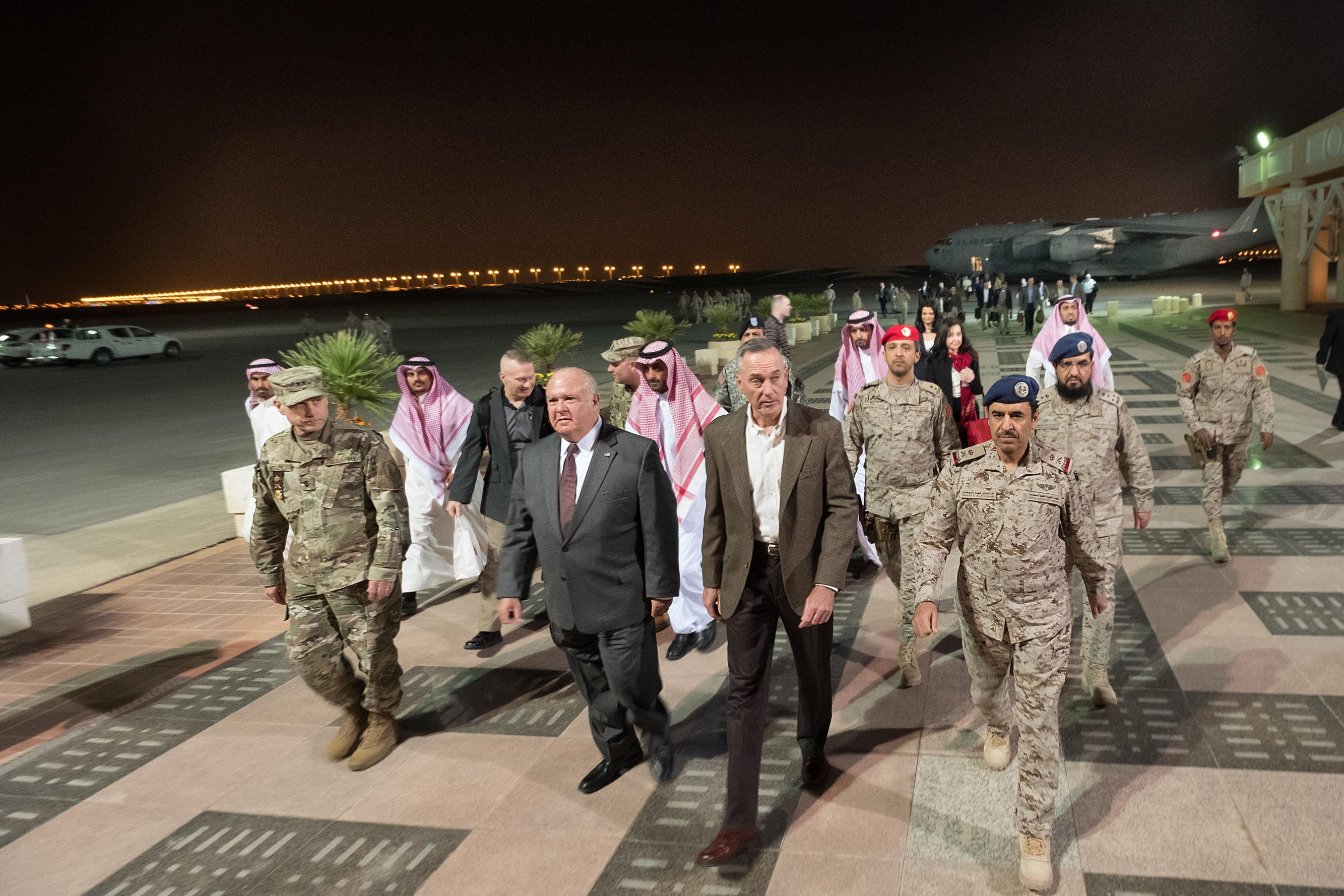 Saudi and American officers escort Marine Corps Gen. Joe Dunford from his C-17.