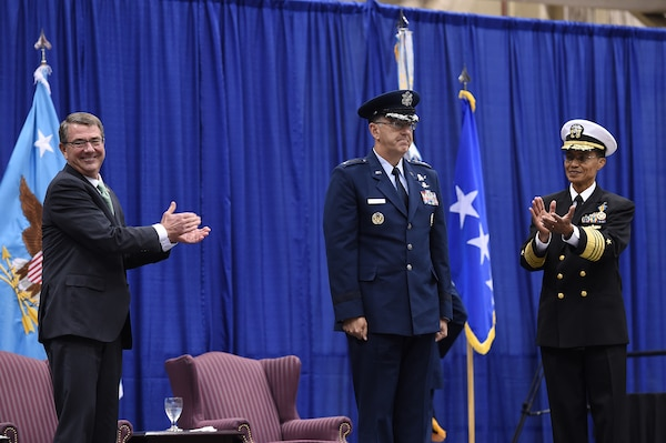 Secretary of Defense Ash Carter (left) and former commander of U.S. Strategic Command (USSTRATCOM) Adm. Cecil D. Haney (right) congratulate new USSTRATCOM commander Gen. John E. Hyten during a change of command ceremony at Offutt Air Force Base, Neb., Nov. 3, 2016. Carter presided over the change of command and provided remarks during which he congratulated Hyten on his appointment and thanked Haney for his service. Additionally, Chairman of the Joint Chiefs of Staff Gen. Joseph F. Dunford provided remarks during the ceremony and presented the Joint Meritorious Unit Award to USSTRATCOM. Hyten previously served as commander of Air Force Space Command, and Haney will retire from active military duty during a separate ceremony in January. One of nine DoD unified combatant commands, USSTRATCOM has global strategic missions assigned through the Unified Command Plan that include strategic deterrence; space operations; cyberspace operations; joint electronic warfare; global strike; missile defense; intelligence, surveillance and reconnaissance; combating weapons of mass destruction; and analysis and targeting. (U.S. Air Force photo by Staff Sgt. Jonathan Lovelady)