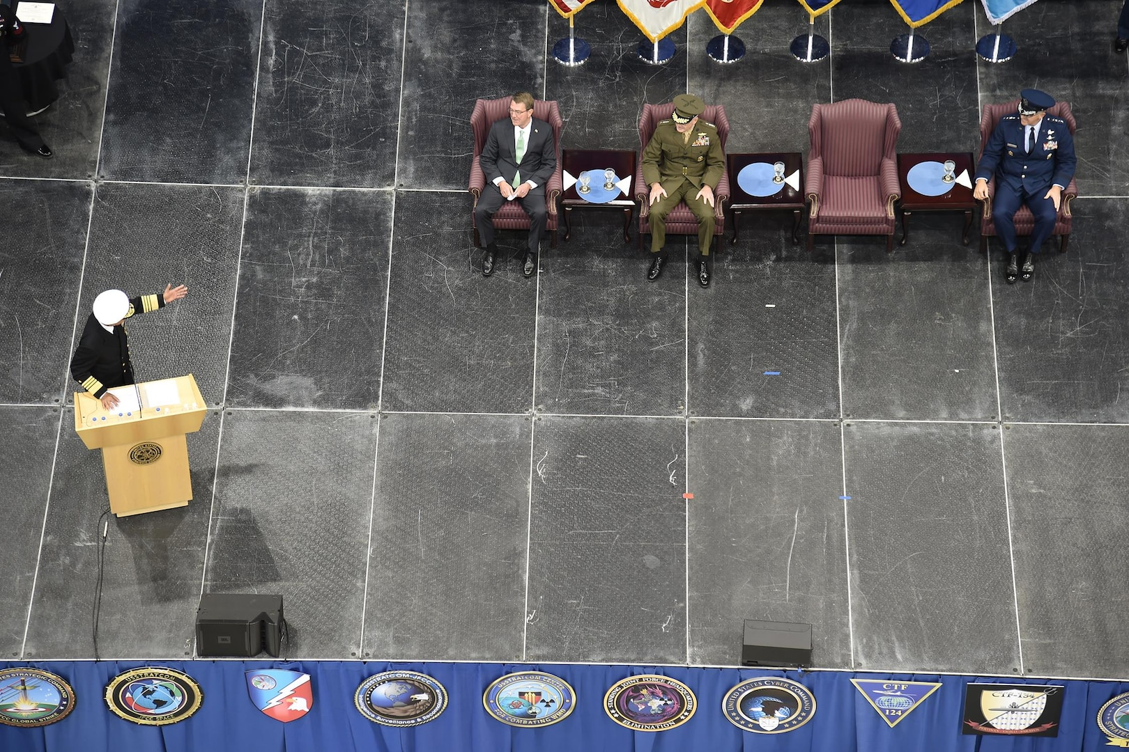 Adm. Cecil D. Haney, outgoing U.S. Strategic Command (USSTRATCOM) commander, speaks to Secretary of Defense Ash Carter, Chairman of the Joint Chiefs of Staff, Gen. Joseph Dunford and Gen. John E. Hyten, incoming USSTRATCOM commander, at USSTRATCOM's change of command ceremony at Offutt Air Force Base, Neb., Nov. 3, 2016. Carter presided over the change of command and provided remarks during which he thanked Adm. Cecil D. Haney, outgoing USSTRATCOM commander, for his service. He also congratulated Gen. John E. Hyten on his appointment as the new USSTRATCOM commander. Additionally, Chairman of the Joint Chiefs of Staff Gen. Joseph F. Dunford provided remarks during the ceremony and presented the Joint Meritorious Unit Award to USSTRATCOM. Hyten previously served as commander of Air Force Space Command, and Haney will retire from active military duty during a separate ceremony in January. One of nine DoD unified combatant commands, USSTRATCOM has global strategic missions assigned through the Unified Command Plan that include strategic deterrence; space operations; cyberspace operations; joint electronic warfare; global strike; missile defense; intelligence, surveillance and reconnaissance; combating weapons of mass destruction; and analysis and targeting. (U.S. Navy photo by Petty Officer 1st Class Byron C. Linder)