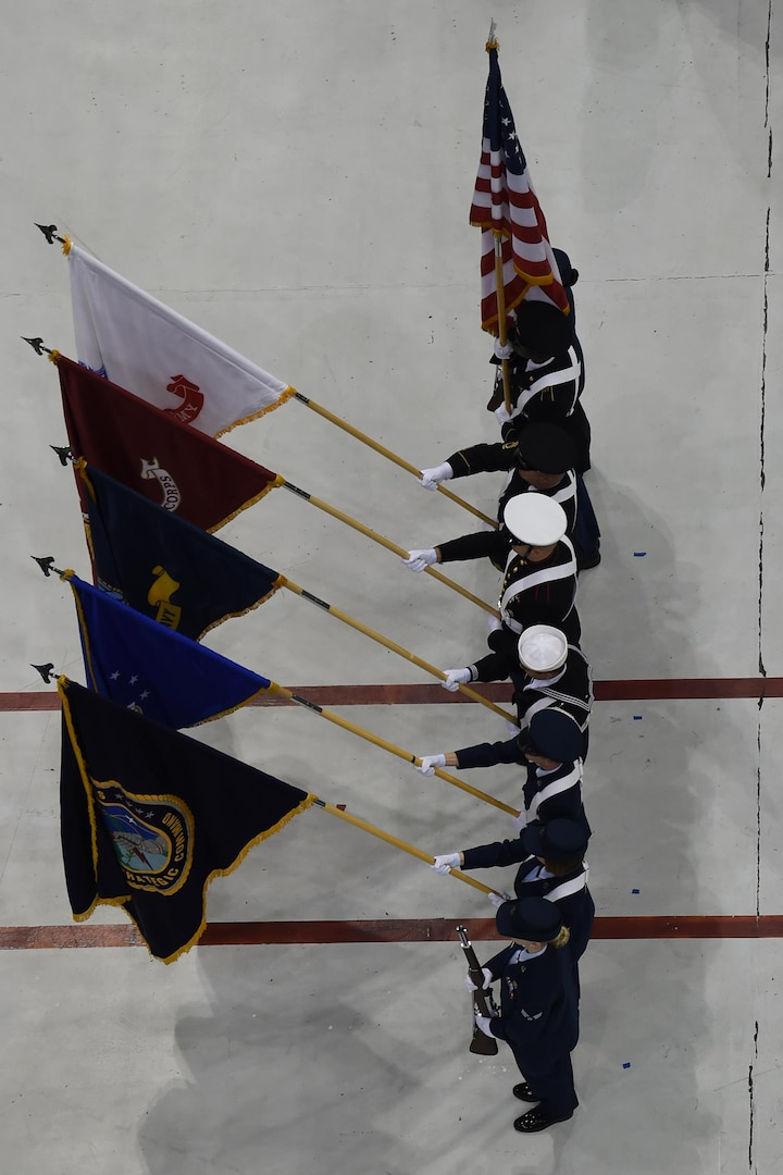 The U.S. Strategic Command (USSTRATCOM) color guard parades the colors during the U.S. Strategic Command (USSTRATCOM) change of command ceremony at Offutt Air Force Base, Neb., Nov. 3, 2016. Secretary of Defense Ash Carter presided over the change of command and provided remarks during which he thanked Adm. Cecil D. Haney, outgoing USSTRATCOM commander, for his service. He also congratulated Gen. John E. Hyten on his appointment as the new USSTRATCOM commander. Additionally, Chairman of the Joint Chiefs of Staff Gen. Joseph F. Dunford provided remarks during the ceremony and presented the Joint Meritorious Unit Award to USSTRATCOM. Hyten previously served as commander of Air Force Space Command, and Haney will retire from active military duty during a separate ceremony in January. One of nine DoD unified combatant commands, USSTRATCOM has global strategic missions assigned through the Unified Command Plan that include strategic deterrence; space operations; cyberspace operations; joint electronic warfare; global strike; missile defense; intelligence, surveillance and reconnaissance; combating weapons of mass destruction; and analysis and targeting. (U.S. Navy photo by Petty Officer 1st Class Byron C. Linder)