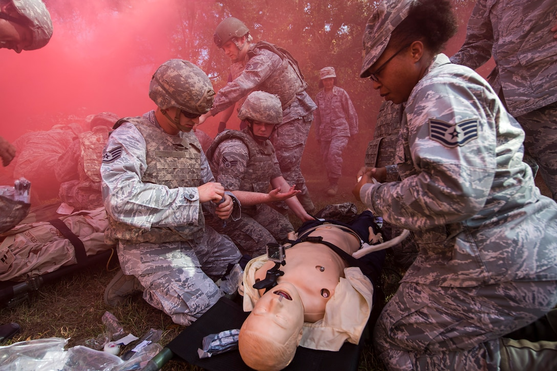 A team of medics treat a simulated casualty, during an Emergency Medical Technician refresher course, Nov. 4, 2016, at Moody Air Force Base, Ga. Medics prioritized transport for each patient based on the severity of their injuries. Team leads relayed the information about each patient to the evaluator which tested their ability to work and communicate as a team. (U.S. Air Force photo by Airman 1st Class Janiqua P. Robinson)