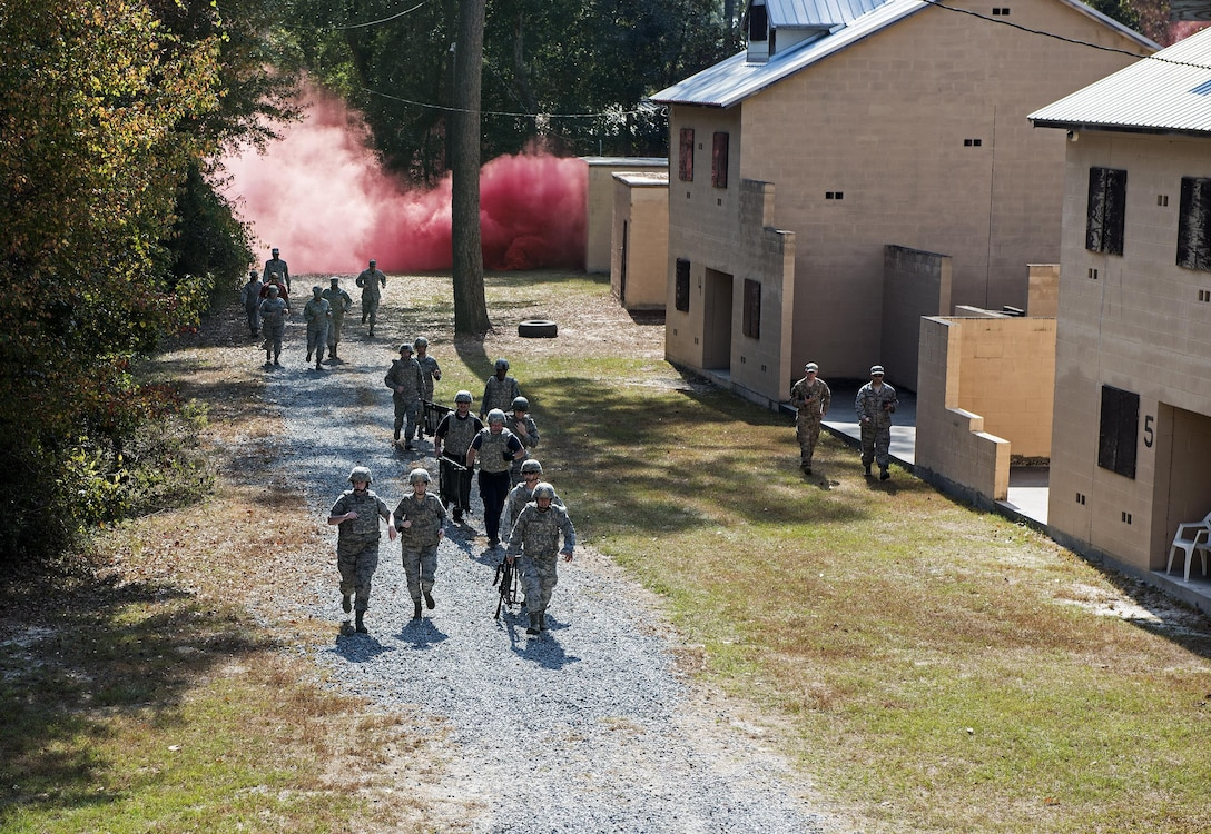 A team of medics respond to a simulated attack during an Emergency Medical Technician refresher course, Nov. 4, 2016, at Moody Air Force Base, Ga. The medics utilized the Military Operations in Urban Terrain village where they were tested on skills they'd spent the week refreshing. (U.S. Air Force photo by Airman 1st Class Janiqua P. Robinson)