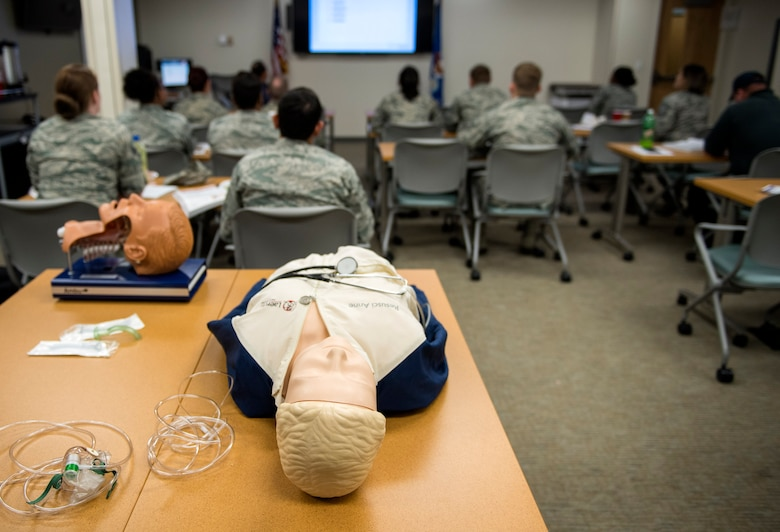 U.S. Air Force guard, reserve and active-duty Airmen and firefighters interact during an Emergency Medical Technician refresher course, Oct. 31, 2016, at Moody Air Force Base, Ga. The week-long training must be completed every two years. (U.S. Air Force photo by Airman 1st Class Janiqua P. Robinson)