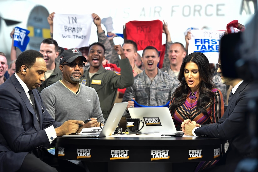 Molly Qerim, ESPN First Take host, is joined by Stephen A. Smith, Max Kellerman and Darius Rucker, Grammy Award-winning singer and songwriter, broadcasting live here as part of their week of Veteran's Day program, Nov. 7, 2016. Every year ESPN First Take honors service members near Veterans Day by telecasting their show from a different base and highlights service members who go above and beyond in their careers.