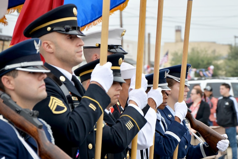 The Goodfellow Air Force Base Joint Service Color Guard marches in the Veterans Day Parade in downtown San Angelo, Texas, Nov. 5, 2016. Service members from the Army, Marine Corps, Navy, Air Force and Coast Guard participated to support the city. (U.S. Air Force photo by Airman 1st Class Randall Moose /Released)