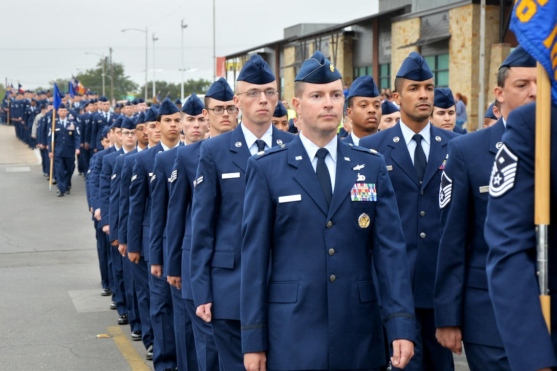 Goodfellow Air Force Base Airmen march in formation during the Veterans Day Parade in downtown San Angelo, Texas, Nov. 5, 2016. The parade featured veterans, active duty, marching bands and more. (U.S. Air Force photo by Airman 1st Class Randall Moose/Released)