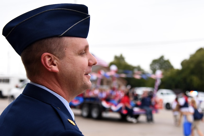 U.S. Air Force Maj. John Travieso, 17th Contracting Squadron Commander, watches the Veterans Day Parade in downtown San Angelo, Texas, Nov. 5, 2016. Travieso marched near the beginning of the parade and finished with enough time to watch the rest. (U.S. Air Force photo by Senior Airman Joshua Edwards/Released)