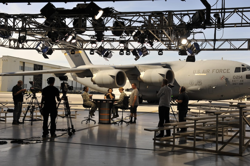 Members of Joint Base Charleston assist the production crew from ESPN's First Take television program set-up in Nose Dock 2, here, Nov. 6, 2016. ESPN First Take filmed a live show Nov. 7 in honor of Veteran's Day.