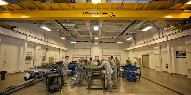 Airmen from the 5th Munitions Squadron assemble inert GBU-38s at Minot Air Force Base, N.D., Oct. 27, 2016. Airmen assembled four guided bomb units as a part of training for an upcoming deployment. (U.S. Air Force photo/Airman 1st Class J.T. Armstrong)