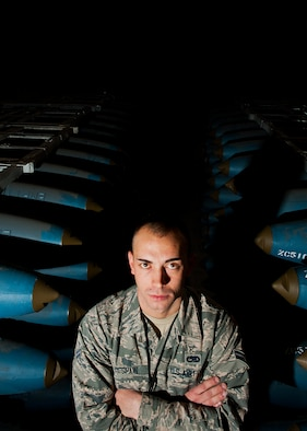 Airman 1st Class Josh DeSpain, 5th Munitions Squadron conventional maintenance crew member, stands between two rows of inert BDU-50 bombs at Minot Air Force Base, N.D., Nov. 2, 2016.  DeSpain was recognized by his squadron leadership with the 5 MUNS Own It Award, for consistent hard work and leadership capabilities. (U.S. Air Force photo/Airman 1st Class J.T. Armstrong)