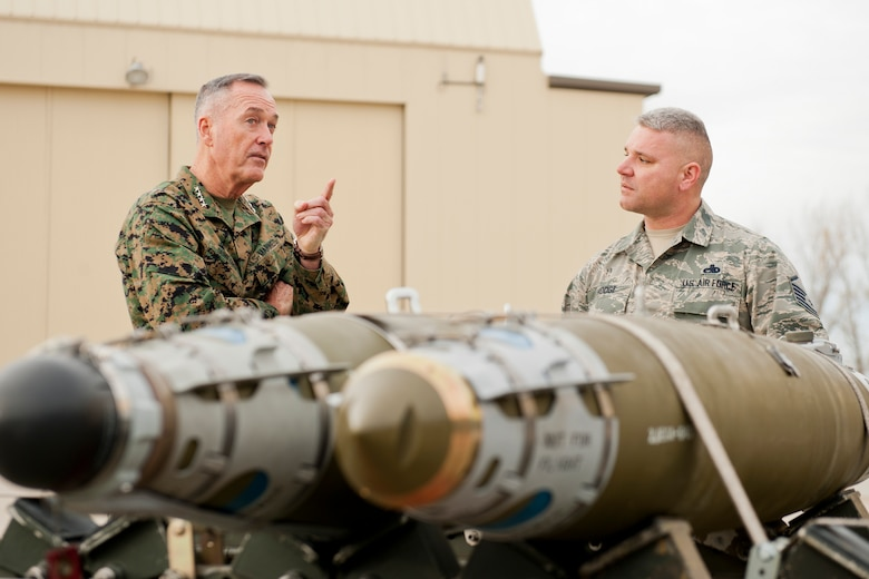 U.S. Marine Corps Gen. Joseph Dunford, chairman of the Joint Chiefs of Staff, speaks to Master Sgt. Daniel Hodge, 5th Aircraft Maintenance Squadron weapons section chief, at Minot Air Force Base, N.D., Nov. 2, 2016. Dunford visited Airmen and spoke about the importance of maintaining a competitive advantage over our adversaries. (U.S. Air Force photo/Airman 1st Class J.T. Armstrong)