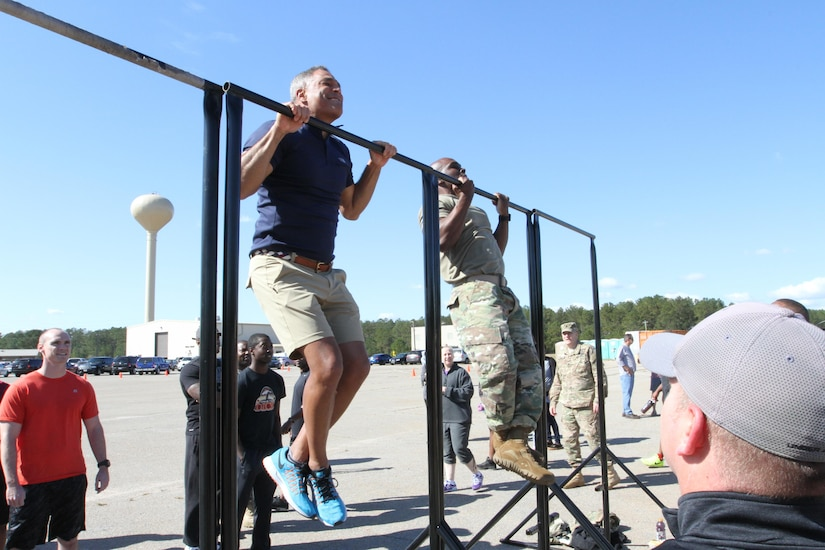 Lt. Gen. Michael X. Garrett (left), U.S. Army Central commanding general, participates in the pull-up bar competition during the USARCENT Organization Day, Nov. 4, at the Shaw Air Force Base Fight House. Soldiers participated in a little friendly competition of pushups, pullups, a litter carry, Humvee push race, a USARCENT history quiz, and tug of war.