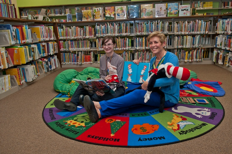 (From left) Julie Reiten, 5th Force Support Squadron, and Ellyn Dunford, spouse to the Chairman Joint Chiefs of Staff, sit with books and stuffed animals in the library at Minot Air Force Base, N.D., Nov. 2, 2016. Dunford toured Minot AFB library and was briefed on its various reading programs. (U.S. Air Force photo/Airman 1st Class Jonathan McElderry)
