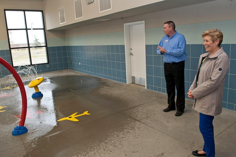 (From left) Michael Lahr, Minot Air Force Base Community Homes manager, shows Ellyn Dunford, spouse to the Chairman Joint Chiefs of Staff, a water playground in the Homes Neighborhood Center at Minot AFB, N.D., Nov. 2, 2016. Dunford toured Minot AFB Homes Neighborhood Center and was briefed on the center's demonstrations and programs. (U.S. Air Force photo/Airman 1st Class Jonathan McElderry)