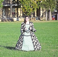 "A volunteer from the Historical and Archeological Society of Fort Riley portrays the ""Woman in Chains"" ghost, which has been reported roaming Artillery Parade Field, during the 20th annual HASFR Ghost Tours Oct. 23."