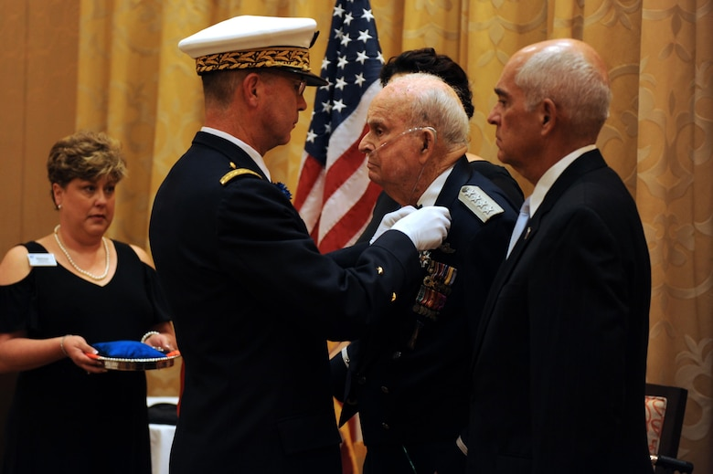 Brig. Gen. Vincent Cousin, Embassy of France in the United States defense attaché, presents retired Gen. Seth McKee, with The Legion of Honor in the Rank of Chevalier Oct. 5, 2016 in Scottsdale, Ariz. McKee is the oldest living American, four Star, general. (U.S. Air Force photo by Airman 1st Class Pedro Mota)