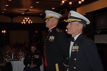 Brig. Gen. John Jansen, Commanding General, 3d Marine Expeditionary Brigade (MEB), and Rear. Adm. Marc H. Dalton, Commander, Amphibious Force 7th Fleet, look on during a ceremony in commemoration of the Marine Corps birthday during the 3d MEB Marine Corps ball. The event celebrated the Marine Corps' 241st birthday with a ceremony and dinner. (U.S. Navy photo by Petty Officer 2nd Class Sarah Villegas)
