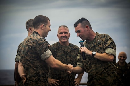 Col. Tye R. Wallace, 31st Marine Expeditionary Unit commanding officer, congratulates Hospital Corpsman 3rd Class Ben Kaplan for his hard work and dedication to serving the Marines of Company G, Battalion Landing Team, 2nd Battalion, 4th Marines, 31st Marine Expeditionary Unit, aboard the USS Germantown (LSD-42), Sept. 23, 2016. As the Marine Corps' only continuously forward deployed unit, the 31st Marine Expeditionary Unit is prepared to respond to a wide range of military operations, from humanitarian assistance missions to limited combat operations, at a moment's notice. As a balanced air-ground-logistics team, the 31st MEU is ready to respond throughout the Asia-Pacific region. (U.S. Marine Corps photo by Lance Cpl. Jorge A. Rosales/released)