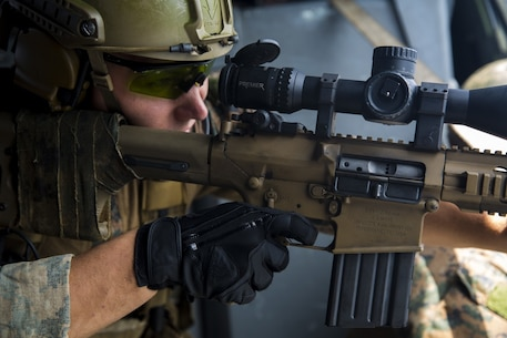 Cpl. Doug Dicka, a force reconnaissance Marine with the 31st Marine Expeditionary Unit, takes aim aboard a MH-60S Seahawk helicopter during aerial sniper training above the Pacific Ocean, Oct. 22, 2016. As the Marine Corps' only continuously forward deployed unit, the 31st Marine Expeditionary Unit is prepared to respond to a wide range of military operations, from humanitarian assistance missions to limited combat operations, at a moment's notice. (U.S. Marine Corps photo by Lance Cpl. David A. Diggs/ Released)