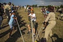 "Scouts from Scout Association of Japan and the Boy Scouts of America participate in a tug-of-war during the 23rd Boy Scouts of America-Scout Association of Japan Friendship Jamborette Nov. 5-6 aboard Camp Kinser, Okinawa, Japan. According to Bockoras, these moments of camaraderie are crucial to Japan-U.S. relations. ""These kids are going to be the future leaders for their countries one day,' said Staff Sgt. Benjamin A. Bockoras. ""So the fact that we're able to foster these partnerships at an early age enhances an already fruitful partnership.""  Bockoras is a radio chief with Headquarters Regiment, 3rd Marine Logistics Group, III Marine Expeditionary Force and a Port Alleghany, Pennsylvania, native. (U.S. Marine Corps photo by Cpl. Daniel Jean-Paul / Released)"