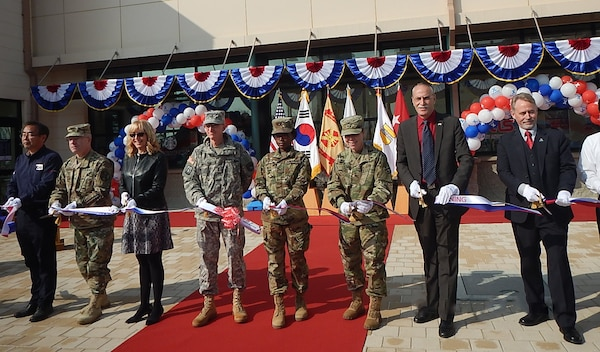 Dignitaries from U.S. Army Garrison Humphreys and Army and Air Force Exchange Service gather to cut the ribbon on a mini mall Nov. 8 at Camp Humphreys