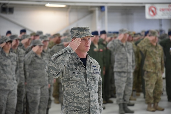 Oregon Air National Guard Col. Christopher Lantagne, 142nd Fighter Wing Maintenance Group commander, center, and other members of the 142nd Fighter Wing render their salute to the colors during the unit's Change of Command ceremony held Nov. 6, 2016, Portland Air National Guard Base, Ore. (U.S. Air National Guard photograph by Senior Master Sgt. Shelly Davison, 142nd Fighter Wing Public Affairs)