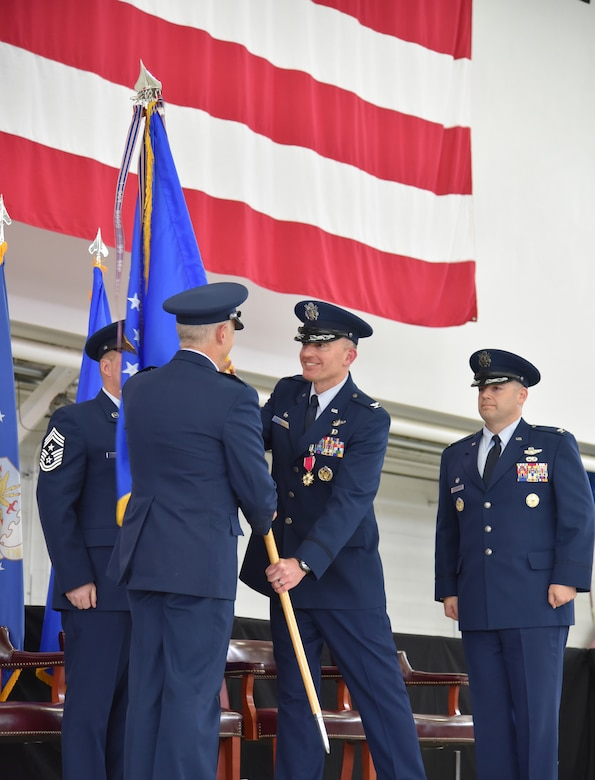 Col. Paul T. Fitzgerald, outgoing 142nd Fighter Wing Commander, hands the Unit Guidon to Maj. Gen. Michael E. Stencel, The Adjutant General, Oregon, as Fitzgerald relinquishes command of the 142nd Fighter Wing during a Change of Command ceremony held Nov. 6, 2016, Portland Air National Guard Base, Ore. (U.S. Air National Guard photograph by Staff Sgt. Brandon Boyd, 142nd Fighter Wing Public Affairs)