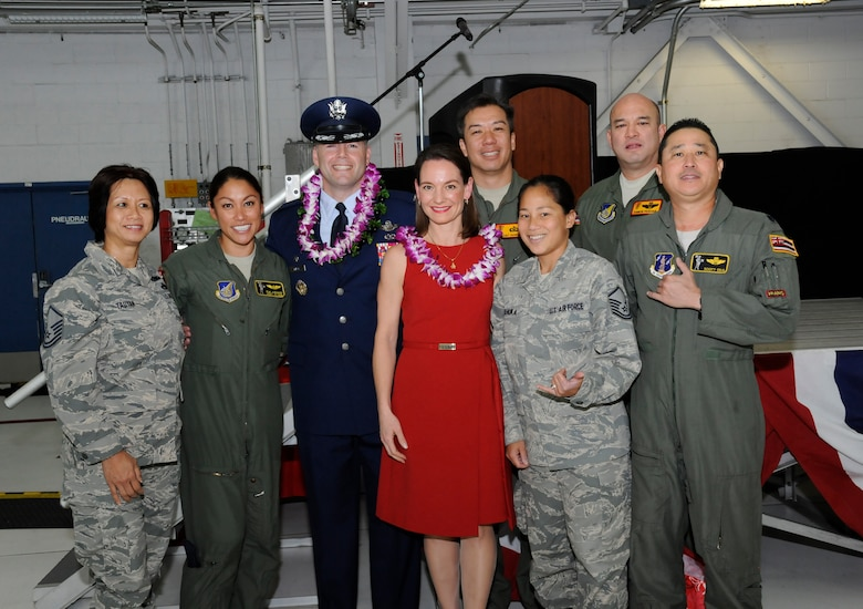 Oregon Air National Guard Col. Duke A. Pirak, and his wife Juli, center, pause for a photograph with members of the Hawaii Air National Guard, who attended the 142nd Fighter Wing Change of Command ceremony, Nov. 6, at the Portland Air National Guard Base, Ore. Pirak had been the Vice Wing commander with the 154th Wing, Hawaii Air National Guard prior to his return to Oregon. (U.S. Air National Guard photo by Tech. Sgt. John Hughel, 142nd Fighter Wing Public Affairs)