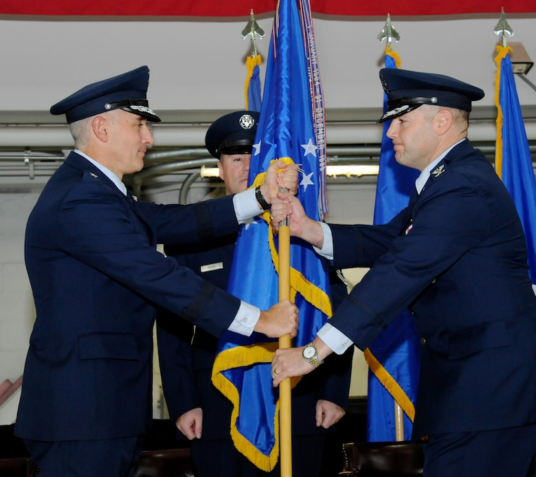 Oregon Air National Guard Brig. Gen. Jeffrey Silver, Oregon Air National Guard commander, left, hands the guidon to incoming 142nd Fighter Wing commander Duke A. Pirak, right, during the formal Change of Command ceremony, Portland Air National Guard Base, Ore., Nov. 6, 2016. (U.S. Air National Guard photo by Tech. Sgt. John Hughel, 142nd Fighter Wing Public Affairs)
