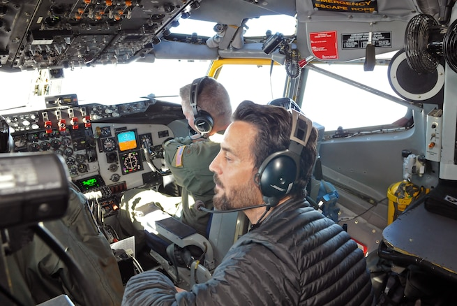 Tony Horton, celebrity trainer and creator of the P90X fitness series, checks out the cockpit of a KC-135 Stratotanker during a civic leader orientation flight on Nov. 3, 2016. Community guests participated in an air refueling sortie designed to educate the group on the 151st Air Refueling Wing's mission and capabilities. (U.S. Air National Guard photo by Staff Sgt. Annie Edwards/Released)