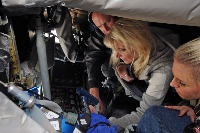 Master Sgt. Jason Blood demonstrates some of  the technical aspects of his job as a KC-135 boom operator to Susan Lucy, Tony Horton's military affairs manager, and Miss Utah Lauren Wilson, during a civic leader orientation flight on Nov. 3, 2016. Community guests participated in an air refueling sortie designed to educate the group on the 151st Air Refueling Wing's mission and capabilities. (U.S. Air National Guard photo by Staff Sgt. Annie Edwards/Released)