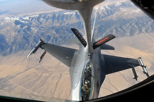 A Utah Air National Guard KC-135 Stratotanker refuels an F-16 from Hill Air Force Base, during a civic leader orientation flight on Nov. 3, 2016. Community guests participated in an air refueling sortie designed to educate the group on the 151st Air Refueling Wing's mission and capabilities. (U.S. Air National Guard photo by Staff Sgt. Annie Edwards/Released)