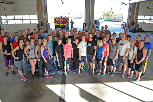 Tony Horton, celebrity fitness trainer and creator of the P90X home workout program, conducts an exercise session for 60 Airmen and dependents Nov. 3, 2016, at Roland R. Wright Air National Guard Base. Horton has conducted 51 morale visits at military installations around the globe,spreading his message of resiliency and healthy lifestyle management. (U.S. Air National Guard photo by Tech. Sgt. Amber Monio/Released)