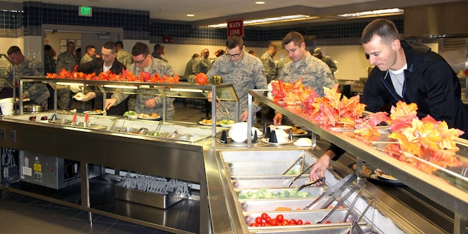 "Airmen of the 127th Wing help themselves to a salad bar with extra ""fixins"" during the November Regularly Scheduled Drill of the 127th Wing, Michigan Air National Guard, at Selfridge Air National Guard Base, Mich., Nov. 5, 2016. The Services Flight of the 127th Force Support Squadron presents a Thanksgiving meal to the Airmen of the 127tth Wing every Thanksgiving. The personnel in the photo in civilian attire are members of the 127th Student Flight, newly-enlisted members who have not yet attended Basic Military Training. (U.S. Air National Guard photo by Tech. Sgt. Dan Heaton)"