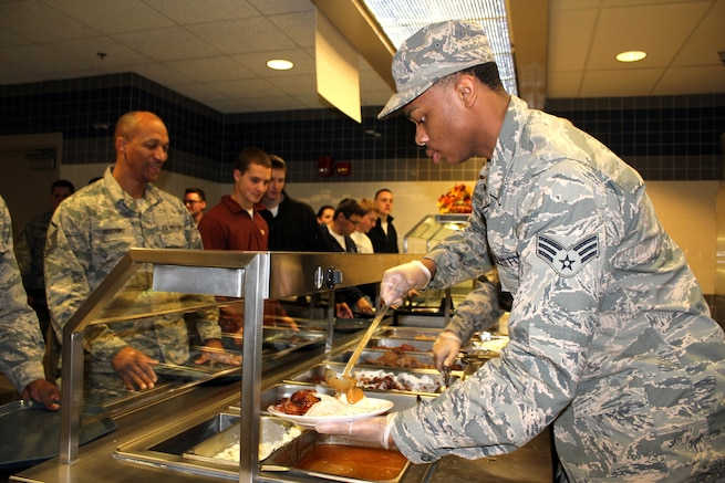 Senior Airman Jaylin Bailey dishes up a traditional Thanksgiving meal, complete with mashed potatoes and gravy, during the November Regularly Scheduled Drill of the 127th Wing, Michigan Air National Guard, at Selfridge Air National Guard Base, Mich., Nov. 5, 2016. Bailey is a member of the Services Flight of the 127th Force Support Squadron, which presents a Thanksgiving meal to the Airmen of the 127tth Wing every Thanksgiving. The personnel in the background of the photo in civilian attire are members of the 127th Student Flight, newly-enlisted members who have not yet attended Basic Military Training. (U.S. Air National Guard photo by Tech. Sgt. Dan Heaton)
