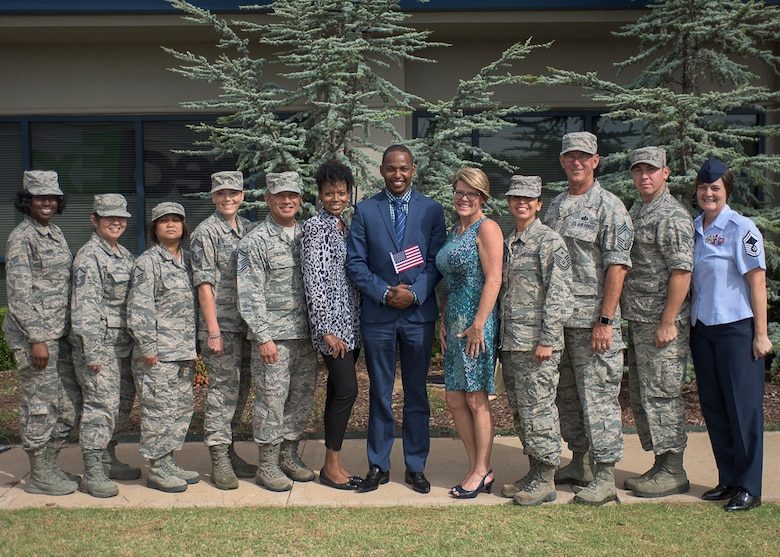 Airman 1st Class Joseph Mwangi, 137th Special Operations Force Support Squadron, became a U.S. citizen, Sept. 13, 2016, in Oklahoma City. His fellow 137th Special Operations Wing Airmen were present at the ceremony to show their support for his once in a lifetime accomplishment. (U.S. Air National Guard photo by Senior Airman Kasey Phipps)