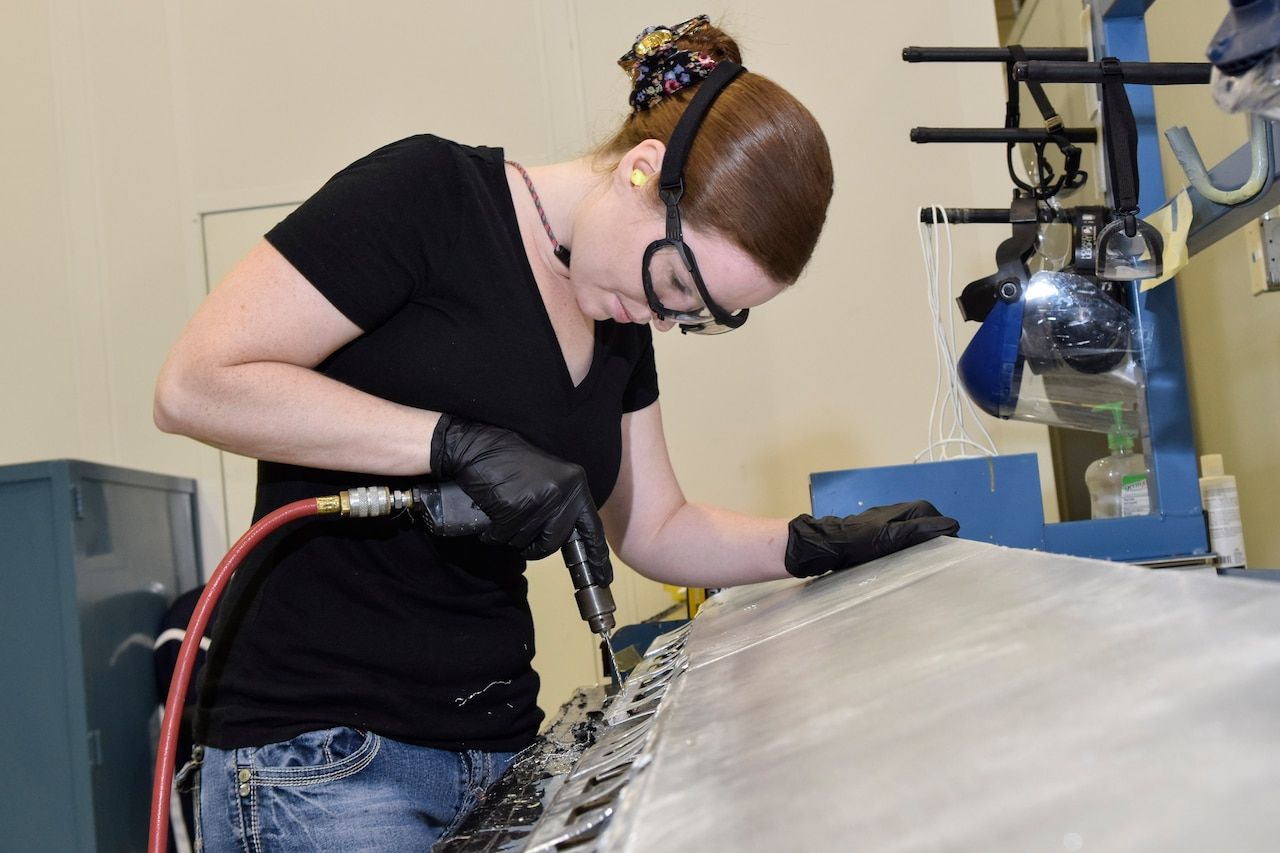 Sarah Holshouser, 553rd Commodities Maintenance Squadron composite fabricator, drills out rivets on a KC-135 aileron she is overhauling at the Oklahoma City Air Logistics Complex, July 25, 2016, Tinker Air Force Base, Okla. The 553rd CMMXS manufactures and maintains components for KC-135, B-1B, B-52H, E-3 and E-6 aircraft.  (U.S. Air Force photo/Greg L. Davis)