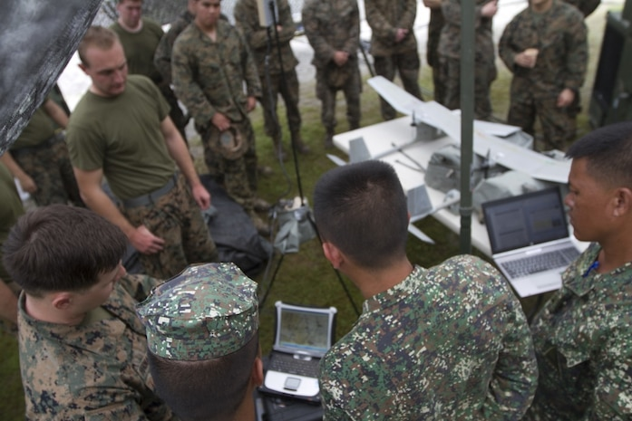 Philippine Marines learn about the RQ-11 Raven unmanned aerial system from U.S. Marines with the 31st Marine Expeditionary Unit during training at Colonel Ernesto Ravina Air Base, Philippines, during Philippine Amphibious Landing Exercise 33 (PHIBLEX), Oct. 8, 2016. The Philippine Marines partner with their U.S. counterparts routinely to share tactics, techniques and procedures to further the U.S-Philippine bilateral partnership. PHIBLEX is an annual U.S.-Philippine military bilateral exercise combining amphibious capabilities and live-fire training with humanitarian civic assistance efforts to strengthen interoperability and working relationships. (U.S. Marine Corps Photo by Staff Sgt. T.T. Parish/Released)