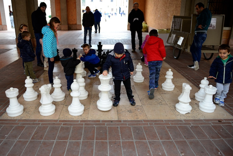 Children play with chess pieces on a chessboard near the city center in Marostica, Italy on Nov. 1, 2016. Marostica is known for its bi-annual, fall, living chess games and annual, spring, cherry festival. (U.S. Air Force photo by Staff Sgt. Krystal Ardrey/Released)