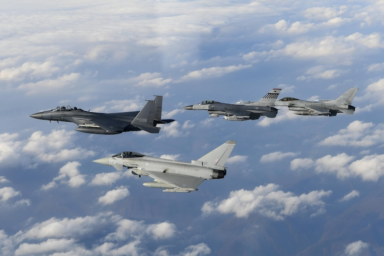 A Royal Air Force Eurofighter Typhoon FRG4, U.S. Air Force F-16 Fighting Falcon, and a Republic of Korea air force F-16 and F-15K Slam Eagle fly in formation during Invincible Shield on Osan Air Base, Republic of Korea, Nov. 7, 2016. The intent of Invincible Shield is to bolster the interoperability between the RoK, the U.S. and United Kingdom while improving combat capability in the Pacific region. (DoD photo by Chief Master Sgt. Kim, Kyeong Ryul, Republic of Korea air force)