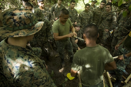 Subscribe  76     Philippine Marine Staff Sgt. Bernaje G. Canindo, a reconnisance marine, demonstrates fire making to U.S. Marines assigned to Fox Company, Battalion Landing Team 2nd Battalion, 4th Marine Regiment, 31st Marine Expeditionary Unit, during a jungle survival class as part of Philippine Amphibious Landing Exercise 33 (PHIBLEX), at Marine Barracks Gregorio Lim, Ternate, Philippines, Oct. 6, 2016. PHIBLEX 33 is an annual bilateral exercise conducted with the Armed Forces of the Philippines that combines amphibious capabilities and live-fire training with humanitarian civic assistance efforts to strengthen interoperability and working relationships through commitment, capability and cooperation. (U.S. Marine Corps photo by Cpl. Darien J. Bjorndal/ Released)