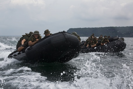 Philippine Marines join U.S. Marines with Fox Company, Battalion Landing Team, 2nd Battalion, 4th Marine Regiment, 31st Marine Expeditionary Unit, during combat rubber raiding craft training as part of Philippine Amphibious Landing Exercise 33 (PHIBLEX) off the coast of Marine Barracks Gregorio Lim, Ternate, Philippines, Oct. 5, 2016. PHIBLEX 33 is an annual bilateral exercise conducted with the Armed Forces of the Philippines that combines amphibious capabilities and live-fire training with humanitarian civic assistance efforts to strengthen interoperability and working relationships through commitment, capability and cooperation. (U.S. Marine Corps photo by Cpl. Darien J. Bjorndal, 31st Marine Expeditionary Unit/ Released)