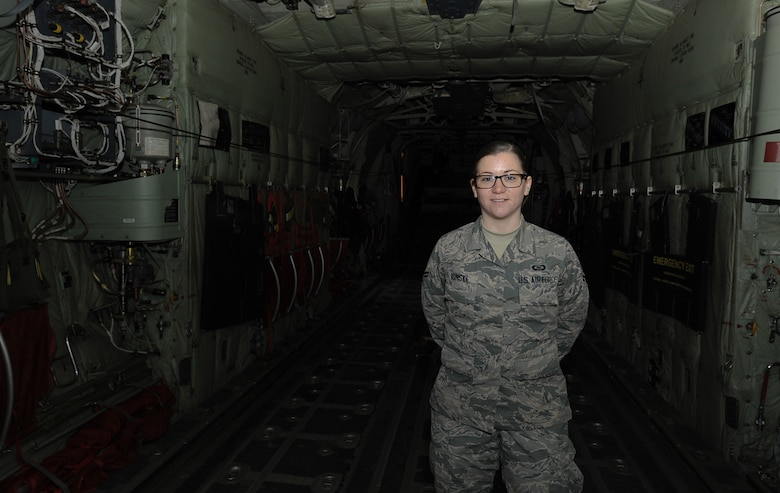 Airman 1st Class Adriya Osinski, 86th Operations Support Squadron aircrew flight equipment apprentice, poses inside of a 37th Airlift Squadron C-130 J Super Hercules aircraft at Ramstein Air Base, Germany, Nov. 4, 2016. Osinski is responsible for inspecting and prepositioning survival equipment on the aircraft, as well as inspecting and maintaining equipment such as oxygen masks, helmets and night vision goggles used for routine flying operations.