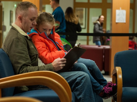 "Ben LeNeave and his daughter, Emma, fill out a pre-appointment form during the 86th Dental Squadron's ""Little Teeth, Big Smile"" event at Ramstein Air Base, Germany, Nov. 5, 2016. The event was a way for children ages up to 10 years old to get their teeth checked or cleaned in an environment tailored to their age group. According to the Center for Disease and Control, tooth decay is one of the most common chronic conditions of childhood in the United States. Untreated cavities can cause pain and infections that may lead to problems with eating, speaking, playing, and learning. (U.S. Air Force photo by Airman 1st Class Lane T. Plummer)"