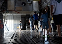 Air show attendees, wait in line to see the flight deck of a U.S. Air Force C-17 Globemaster III cargo aircraft, assigned to the 97th Air Mobility Wing, during the 2016 Stuart Air Show, Nov. 5, 2016 at Stuart, Florida. The C-17 was set up as a static display during the air show to help educate attendees about its capabilities and the 97th AMW training mission. (U.S. Air Force photo by Senior Airman Franklin R. Ramos/Released)