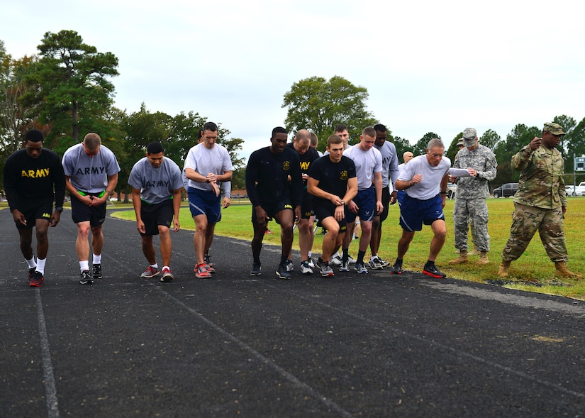 U.S. Air Force Airmen, U.S. Army Soldiers and U.S. Navy Sailors start the 1,000 meter run, two and a half laps on the track, during the German Armed Forces Badge for military Proficiency event at Joint Base Langley-Eustis, Va., Nov. 1, 2016.  The GAFPB 1,000 meter run is just one of five events and must be completed within six minutes and 30 seconds to qualify.  There is a bronze, silver and gold ranking system used to award qualifying participants.  (U.S. Air Force photo/Tech Sgt. Daylena S. Ricks)