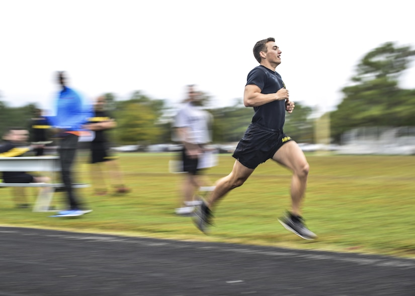 An U.S. Army Soldier sprints the 1,000 meter run, two and a half laps on the track, during the German Armed Forces Badge for military Proficiency event at Joint Base Langley-Eustis, Va., Nov. 1, 2016.  The runner starts at the 200-meter mark and must run two complete laps of the race, the runner's time is recorded to the second. There is a bronze, silver and gold ranking system used from the total of all six events.  (U.S. Air Force photo/Tech Sgt. Daylena S. Ricks)